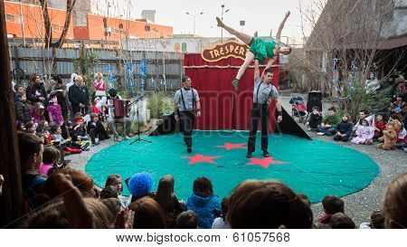 Artists Performing In Their Acrobatic Show At Milan Clown Festival 2014