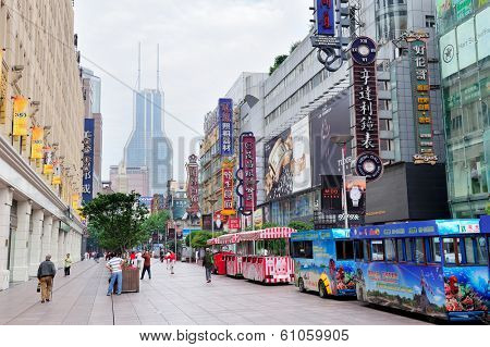 SHANGHAI, CHINA - MAY 28: Nanjing Road street view on May 28, 2012 in Shanghai, China. Nanjing Road is 6km long as the world's longest shopping district with 1M visitors daily.