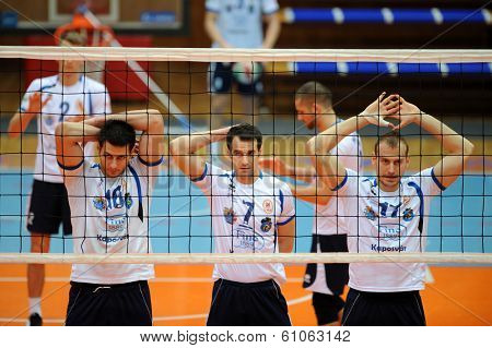 KAPOSVAR, HUNGARY - FEBRUARY 25: Kaposvar players in action at a Hungarian National Championship volleyball game Kaposvar (white) vs. Sumeg (green), February 25, 2014 in Kaposvar, Hungary.
