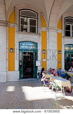 Lisbon, Portugal - August 10, 2013: The historical Cafe Martinho da Arcada. The oldest cafe of Lisbon (18th c.) located in the iconic Comercio Square.
