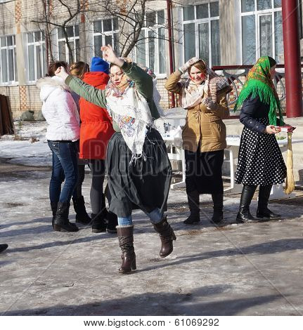 Mstyora,Russia-February 28,2014:Girl dances on holiday of the Shrovetide