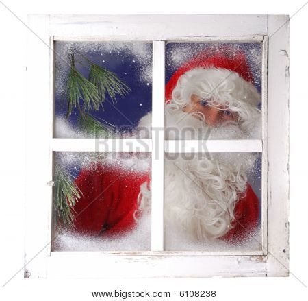 Santa Claus Looking From Behind A Frozen Window
