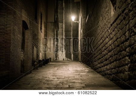 Empty street at night in Barri Gotic quarter in Barcelona, Spain