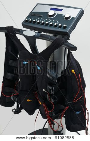 Training suit hanging on Modern Electro Muscular Stimulation EMS machine