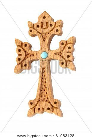wooden cross decorated with turquoise bead isolated on white
