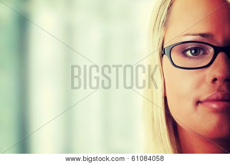 Young beautiful blond woman in glases