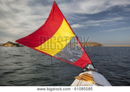 canoe bow with a downwind sail  on Horsetooth Reservoir in Colorado near Fort Collins