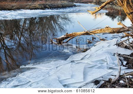Cache la Poudre River in Fort Collins, Colorado, winter or early spring scenery with icy shores