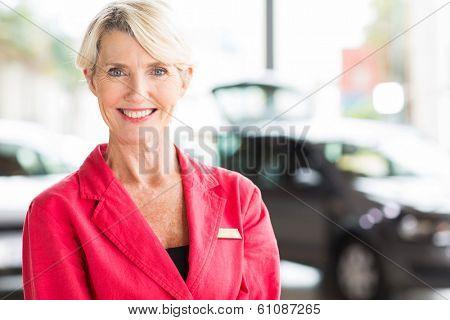 beautiful senior woman working at car dealership
