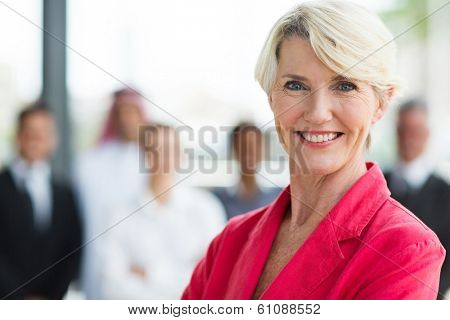 happy senior businesswoman looking at the camera