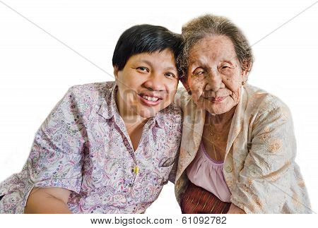 Family Portrait Of An Asian Elder Mother And Daughter Hugging In Isolated Background