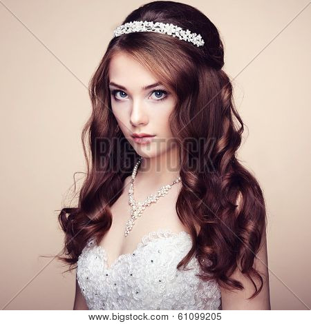 Portrait Of Beautiful Sensual Woman With Elegant Hairstyle. Wedding Dress
