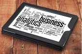 business analytics word cloud - a digital tablet on a rustic wooden table