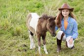 stock photo of foal  - Little foal and girl  - JPG