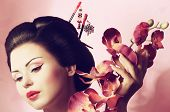 image of geisha  - Portrait of a Japanese geisha woman on the pink background - JPG