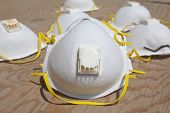 pic of osha  - White dust mask closeup isolated over plywood - JPG