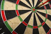 foto of bullseye  - Dart board with dark on bullseye  - JPG