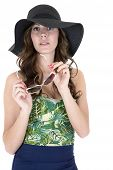 foto of one piece swimsuit  - female model wearing swimsuit sunglasses and hat - JPG