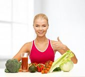 fitness, diet and food concept - young woman with organic food showing thumbs up