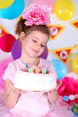 Pretty little girl with cake celebrate her birthday