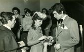 LODZ, POLAND, CIRCA SEVENTIES - Vintage photo of newlyweds during civil marriage ceremony