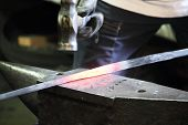 picture of blacksmith shop  - Blacksmith making sword in a forge of Toledo