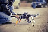 stock photo of drone  - Preparing to filming video using quadrocopter flying drone - JPG
