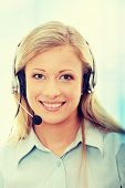Call center woman with headset.Over abstract blue background