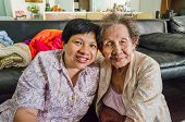 foto of niece  - Family Portrait of an Asian elder mother and daughter hold together in home scenery - JPG