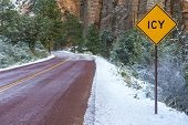 picture of icy road  - Landscape with road in winter forest and road sign ICY - JPG