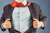 stock photo of open shirt breast showing  - Business man opens his jacket space for text face is visible - JPG