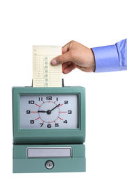 foto of knockout  - Hand putting card in time clock on white background - JPG