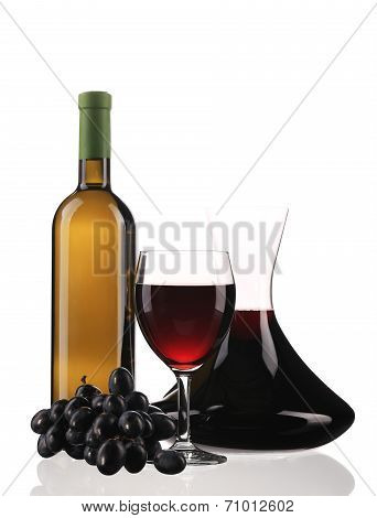 Decanter bottle and glass with red wine.