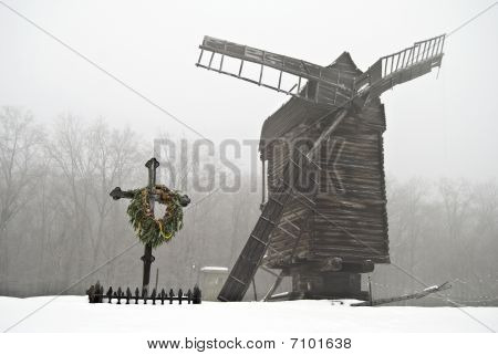 antique wooden windmill in winter