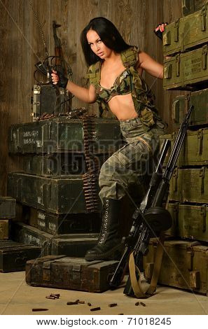 Sexy brunette woman with gun
