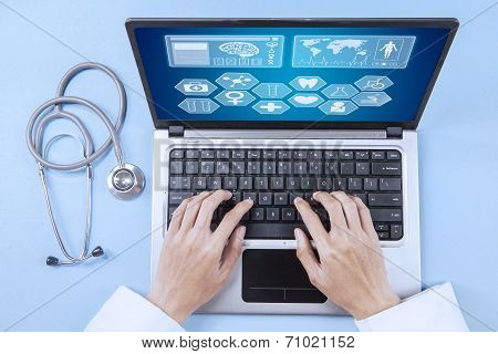 Doctor Analyzing Human Illness On Laptop