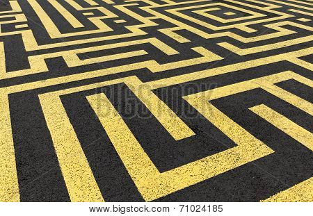 Yellow Labyrinth Painted On A Black Asphalt Road