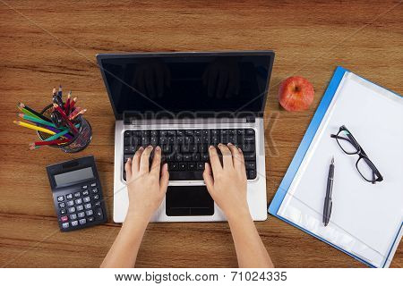 Student Hands Typing On Laptop