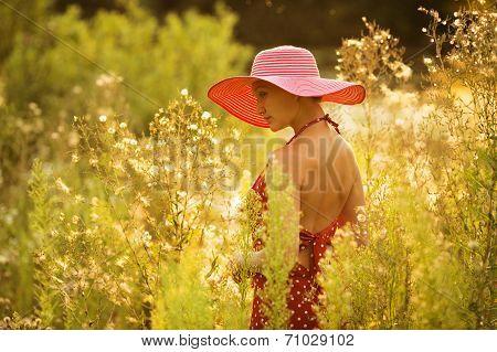 Beautiful Woman Walks Among High Wildflowers