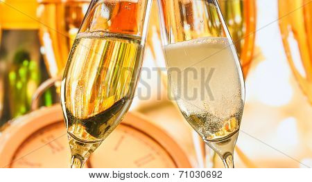 New Year Or Christmas At Midnight With Champagne Flutes Make Cheers On Blur Background