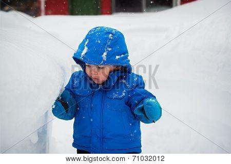 Boy Touching A Deep Snowbank