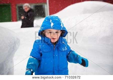 Happy Little Boy Outside On A Snowy Day