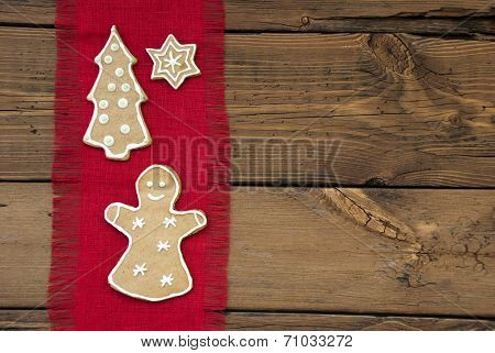 Ginger Bread On Red And Wooden Background