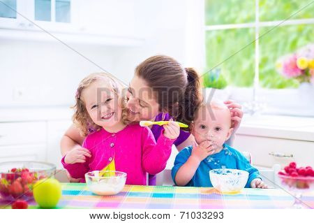 Mother And Kids Having Breakfast poster