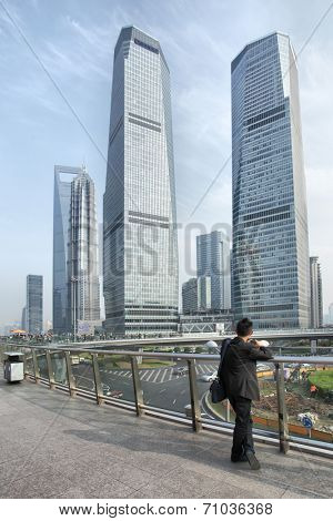 SHANGHAI, CHINA - APRIL 8, 2014: Shanghai Lujiazui flyover and buildings of Pudong New Area