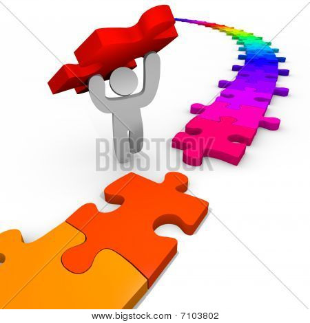 Puzzle - Person Lifts Piece Into Place