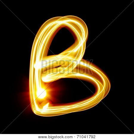 B - Created by light alphabet over black background