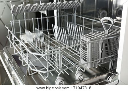 Open dishwasher without dishes in it