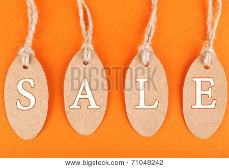 Sale tags on colorful background