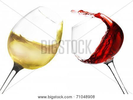 Wineglasses with red and white wine, isolated on white
